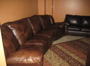 Ocean Blue Private Media Room with Luxury Leather Sofas with Recliners - Vacation Rentals Myrtle Beach